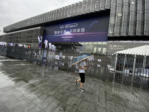 A person walks by the entrance to the World Artificial intelligence Conference in Shanghai, China on July 9, 2020. (Reuters/Wu Ming)