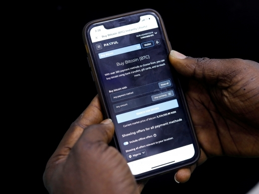 Abolaji Odunjo demonstrates a bitcoin application on his mobile phone in Lagos, Nigeria on August 31, 2020. (Reuters/Temilade Adelaja)