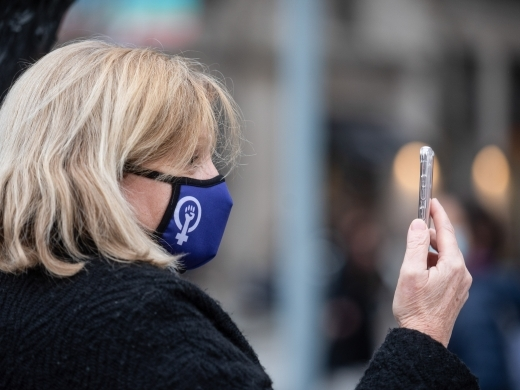A woman speaks on phone as she takes part in the International Women's Day march. (Photo by Xavi Ariza / SOPA Images)