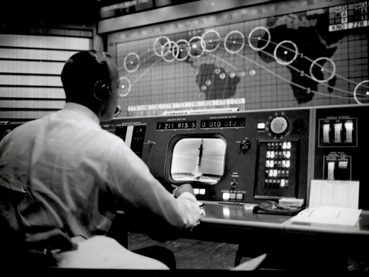 Astronaut Alan B. Shepard monitoring the launch of Mercury-Redstone 4 at the CAPCOM console in Mercury Control Center. (NASA Photo)