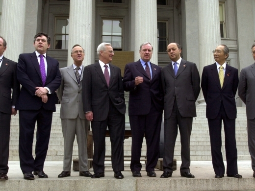 Group of Seven finance ministers gather on the steps of the US Treasury Department on April 20, 2002, in Washington. (AP Photo/Kenneth Lambert)