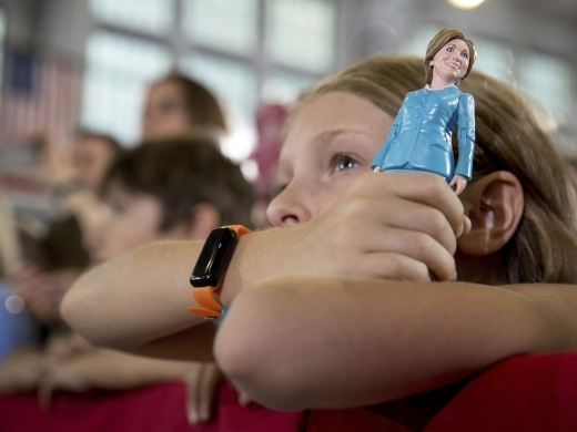 A girl in the audience holds a figurine at a rally in Akron, Ohio (AP Photo/Andrew Harnik)