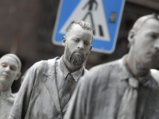 G20 protesters painted like clay figures on the streets of Hamburg (AP Photo/Matthias Schrader)