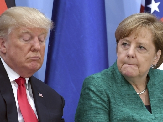 US President Donald Trump and German Chancellor Angela Merkel (Michael Kappeler/Pool Photo via AP)