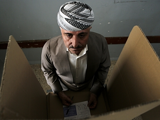 An Iraqi Kurdish man prepares to casts his ballot during the referendum on independence from Iraq in Irbil, Iraq, Monday, Sept. 25, 2017. (AP Photo/Khalid Mohammed)