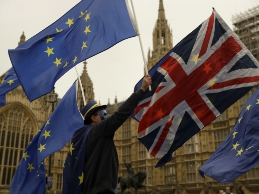Pro-EU supporters hold European Union flags (AP Photo/Matt Dunham)