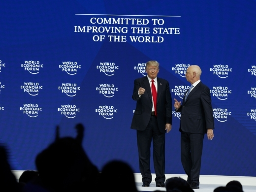 President Donald Trump stands with World Economic Forum's Klaus Schwab after delivering a speech, on January 26, 2018, in Davos. (AP Photo/Evan Vucci)