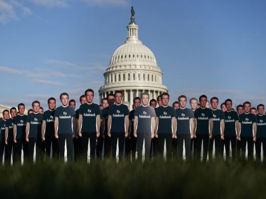 Life-sized cutouts depicting Facebook CEO Mark Zuckerberg are displayed by advocacy group, Avaaz, on the lawn of the Capitol in Washington ahead of Zuckerberg's appearance before a Senate Judiciary and Commerce Committees joint hearing. (AP Photo/Carolyn Kaster)