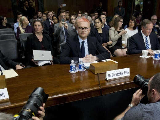Christopher Wylie accompanied by Prof. Eitan Hersh and Dr. Mark A. Jamison during a hearing before the Senate Judiciary Committee on Cambridge Analytica at Capitol Hill, Wednesday, May 16, 2018, in Washington. ( AP Photo/Jose Luis Magana)