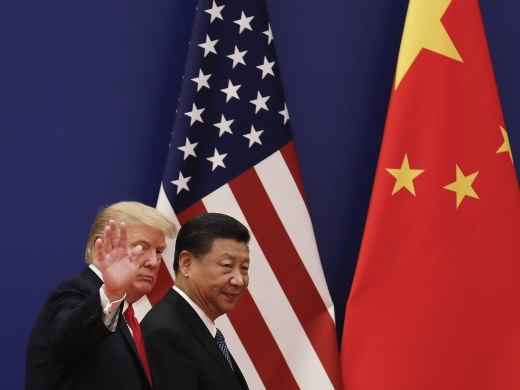 US President Donald Trump waves next to Chinese President Xi Jinping after attending an event at the Great Hall of the People in Beijing in 2017. (AP Photo/Andy Wong, File)