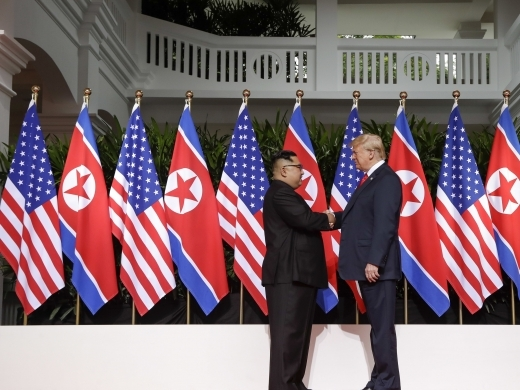 US President Donald Trump shakes hands with North Korea leader Kim Jong Un on June 12, 2018 in Singapore. (AP Photo/Evan Vucci)