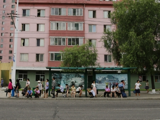 People wait for public transport for their morning commute in Pyongyang, North Korea on July 25, 2018. (AP Photo/Dita Alangkara)