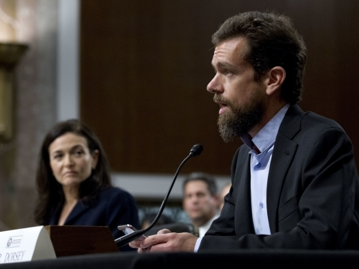 Twitter CEO Jack Dorsey, accompanied by Facebook COO Sheryl Sandberg, testify before the Senate Intelligence Committee in Washington on September 5, 2018. (AP Photo/Jose Luis Magana)