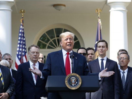 President Donald Trump announces the revamped North American free trade deal in the Rose Garden of the White House on October 1, 2018. (AP Photo/Pablo Martinez Monsivais)