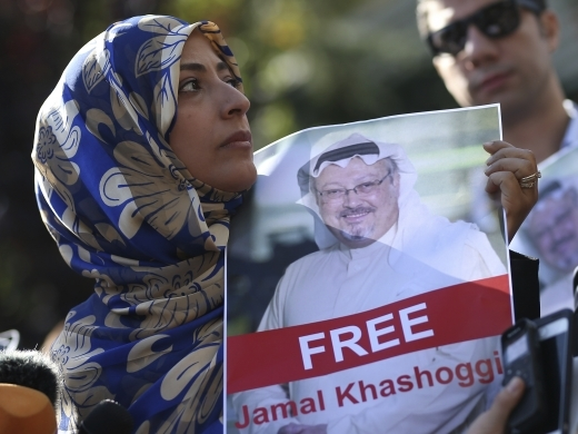 Tawakkol Karman, the Nobel Peace Prize laureate for 2011, holds a picture of Saudi writer Jamal Khashoggi as she speaks to journalists near the Saudi Arabia consulate, in Istanbul, Turkey. (AP Photo/Emrah Gurel, File)