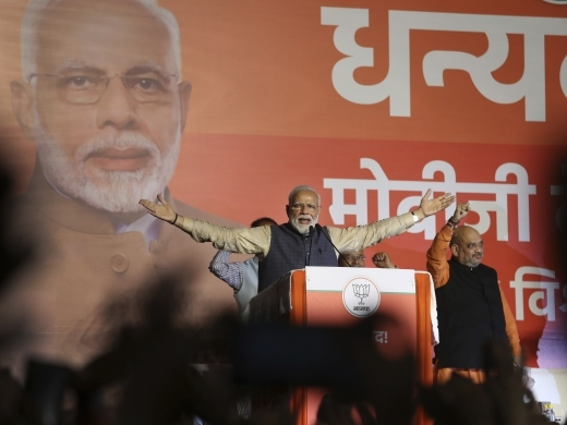 Indian Prime Minister Narendra Modi addresses party supporters, standing next to his Bharatiya Janata Party (BJP) President Amit Shah at their headquarters in New Delhi, India on May 23, 2019. (AP Photo/Manish Swarup)