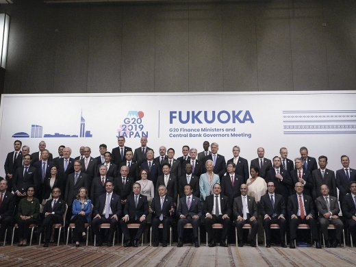 "The G20 finance ministers and central bank governors gather for the annual ""family photo"" during their meeting in Fukuoka, western Japan on June 9, 2019. (AP Photo/Eugene Hoshiko)"