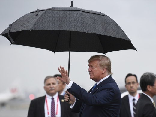 President Donald Trump waves after arriving at Osaka International Airport on June 27, 2019. (AP Photo/Susan Walsh)