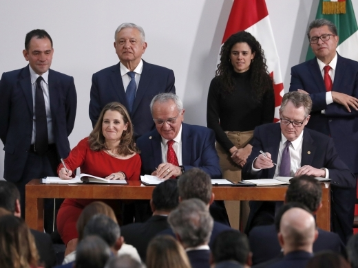 Deputy Prime Minister of Canada Chrystia Freeland, Mexico's top trade negotiator Jesus Seade and US Trade Representative Robert Lighthizer sign an update to the North American Free Trade Agreement, at the national palace in Mexico City, on December 10, 2019. (AP Photo/Marco Ugarte)
