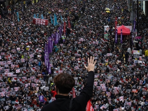 "A protestor shows a ""five demands"" gesture while participating in the annual pro-democracy march in Hong Kong, on  January 1, 2020. (AP Photo/Vincent Yu)"