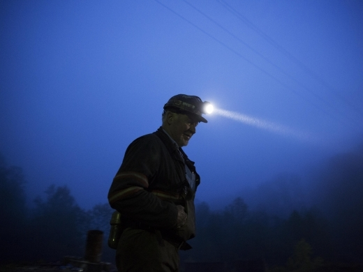 Coal miner Scott Tiller prepares to head into an underground mine at dusk in Welch, West Virginia (AP Photo/David Goldman)