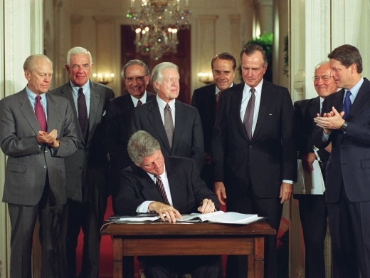 U.S. President Bill Clinton signs the North American Free Trade Agreement (NAFTA)