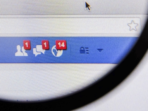 Magnifying glass of Facebook page friend message feed on browser.