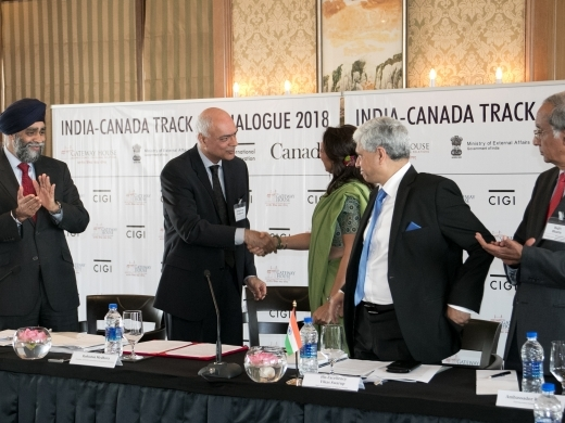 Rohinton Medhora, CIGI president and Manjeet Kripalani, Gateway House co-founder and executive director, shake hands at the February 2018 official launch of the  Canada-India Track 1.5 Dialogue on Innovation, Growth and Prosperity . Photograph by Virpratap Vikram Singh.