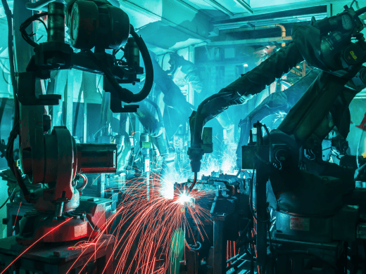 Welding robots movement in a factory (Shutterstock)