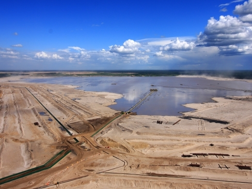 According to a complaint filed with the Commission for Environmental Cooperation, millions of litres of tailings ponds water are leaking into the Athabasca River basin. (Shutterstock)