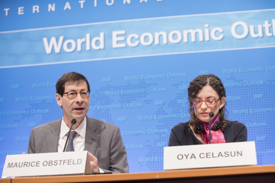 IMF Chief Economist Maurice Obstfeld and Research Division Chief Oya Celasun present the World Economic Outlook (IMF Staff/Stephen Jaffe)