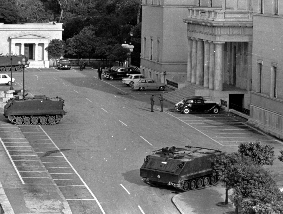 Tanks and troops stand guard outside the Parliament building in Athens, Greece, April 22, 1967, following a coup d'état that installed a military junta. At the time the photo was taken, a curfew was still in effect and troops and tanks remained positioned at communication centres and approaches to the capital. (AP Photo)