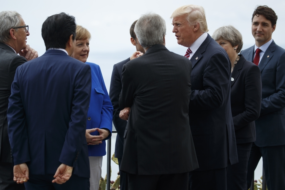European Commission President Jean-Claude Juncker, Japan's Prime Minister Shinzo Abe, German Chancellor Angela Merkel, French President Emmanuel Macron, Italian Prime Minister Paolo Gentiloni, US President Donald Trump, British Prime Minister Theresa May and Canadian Prime Minister Justin Trudeau chat during a walking tour of the ancient Greek theatre of Taormina during G7 summit in Italy (AP Photo/Evan Vucci)