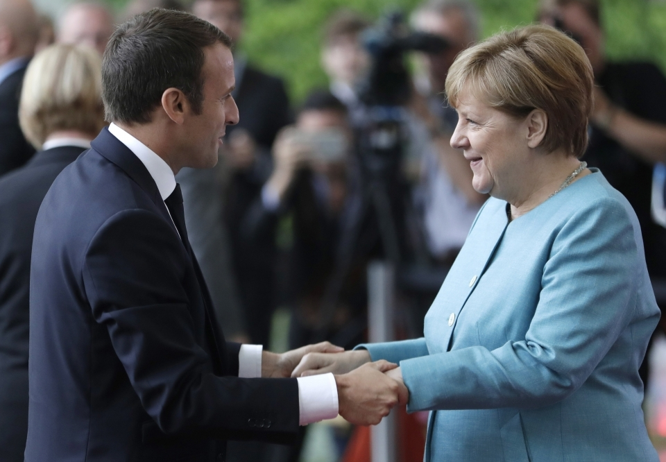 France's President Emmanuel Macron meets Merkel to prepare for G20 summit (AP Photo/Michael Sohn)