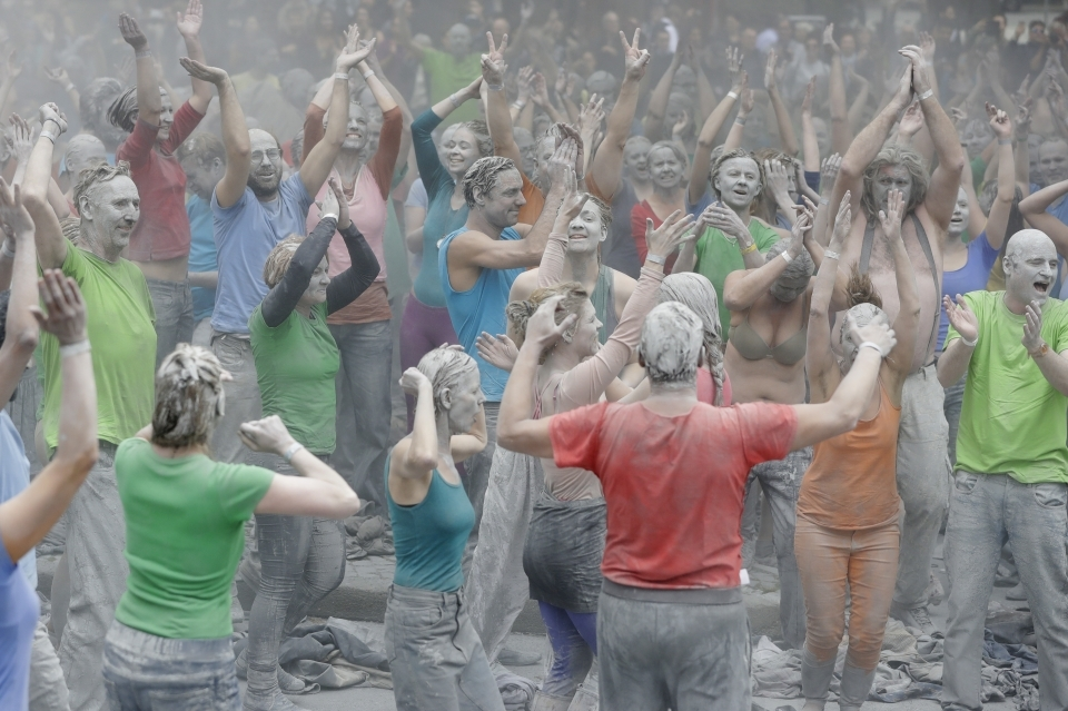 G20 protesters celebrate and shake off clay after a performance in Hamburg (AP Photo/Matthias Schrader)