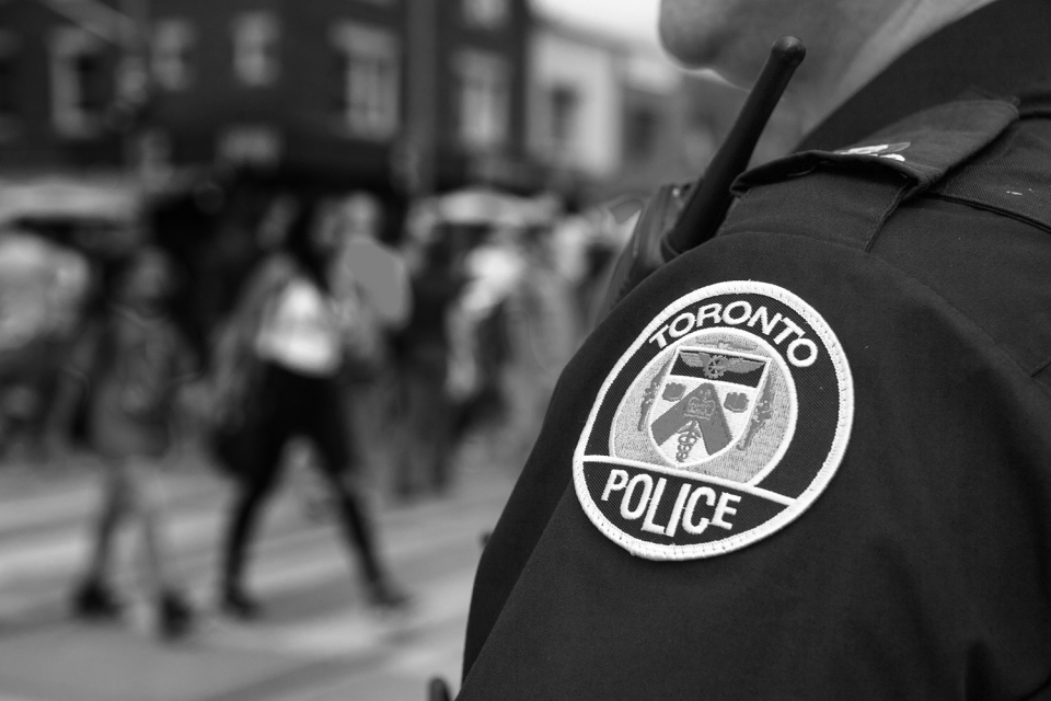 There is concern that biased policing techniques, such as broken windows policing, including stop and frisk, contribute to biased police data. Canada is not immune to problematic policing practice; current enforcement may disproportionately impact poor neighbourhoods and racialized communities. (Photo: Toronto-Images.Com / Shutterstock.com)