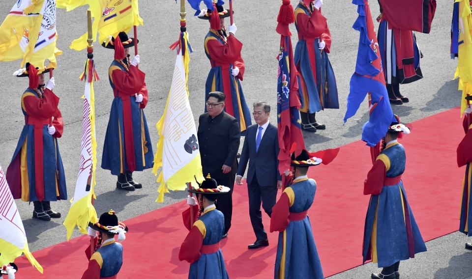 North Korean leader Kim Jong-un and South Korean President Moon Jae-in walk together at the border village of Panmunjom in the Demilitarized Zone on April 27, 2018. (Korea Summit Press Pool via AP)