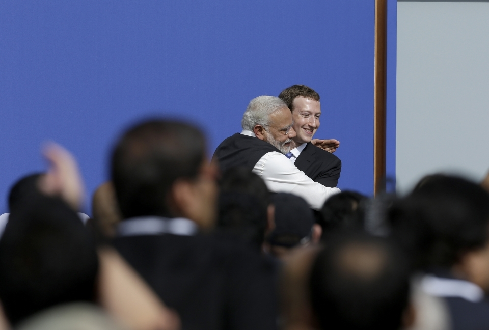 Facebook CEO Mark Zuckerberg, right, hugs Prime Minister of India Narendra Modi at Facebook in California in September, 2015. (AP Photo/Jeff Chiu)