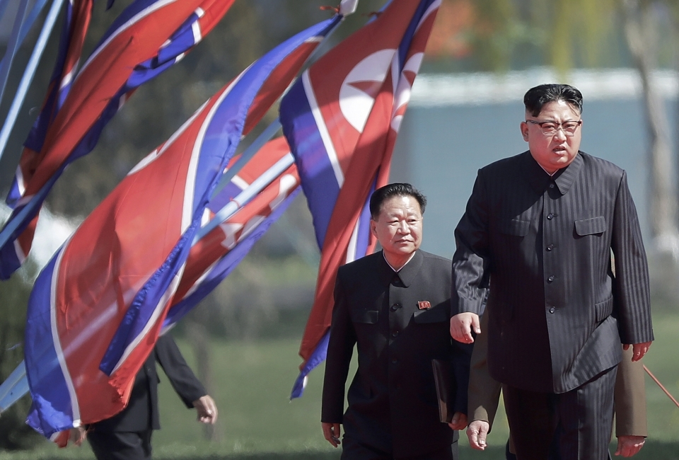 North Korean Kim Jong Un and Choe Ryong Hae arrive for the official opening of the Ryomyong residential area in April, 2017. (AP Photo/Wong Maye-E)