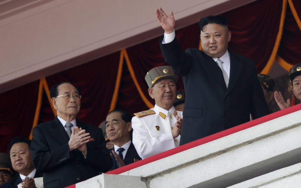 North Korean leader Kim Jong Un waves while officials, from left, Choe Ryong Hae, Kim Yong Nam, Pak Pong Ju, and Hwang Pyong So applaud during a military parade in Pyongyang. (AP Photo/Wong Maye-E, File)