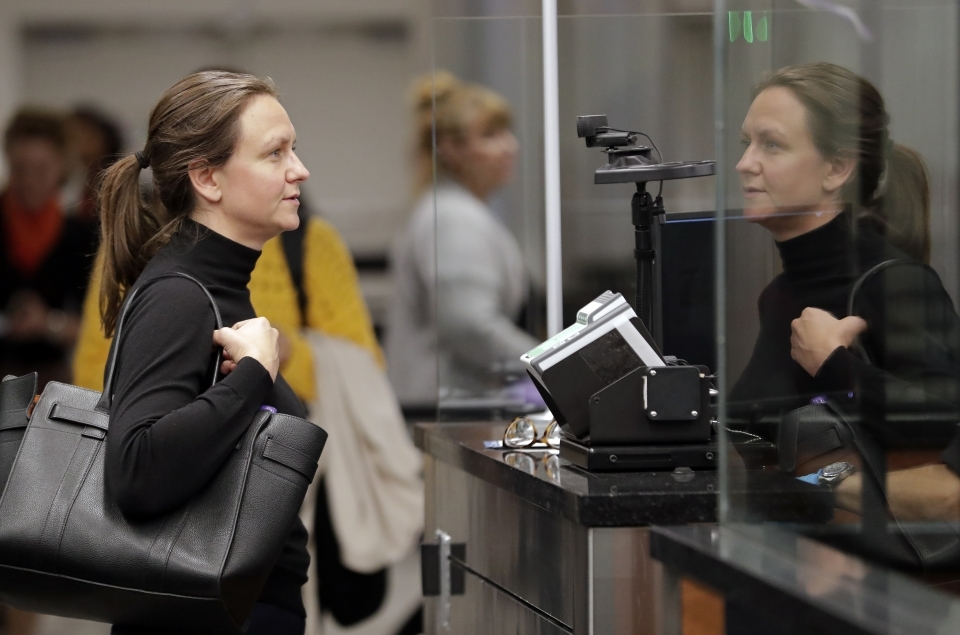 A visitor from Denmark stands in front of a face recognition camera after arriving at customs at Orlando International Airport on June 21, 2018. Florida's busiest airport is becoming the first in the nation to require a face scan of passengers on all arriving and departing international flights. (AP Photo/John Raoux)