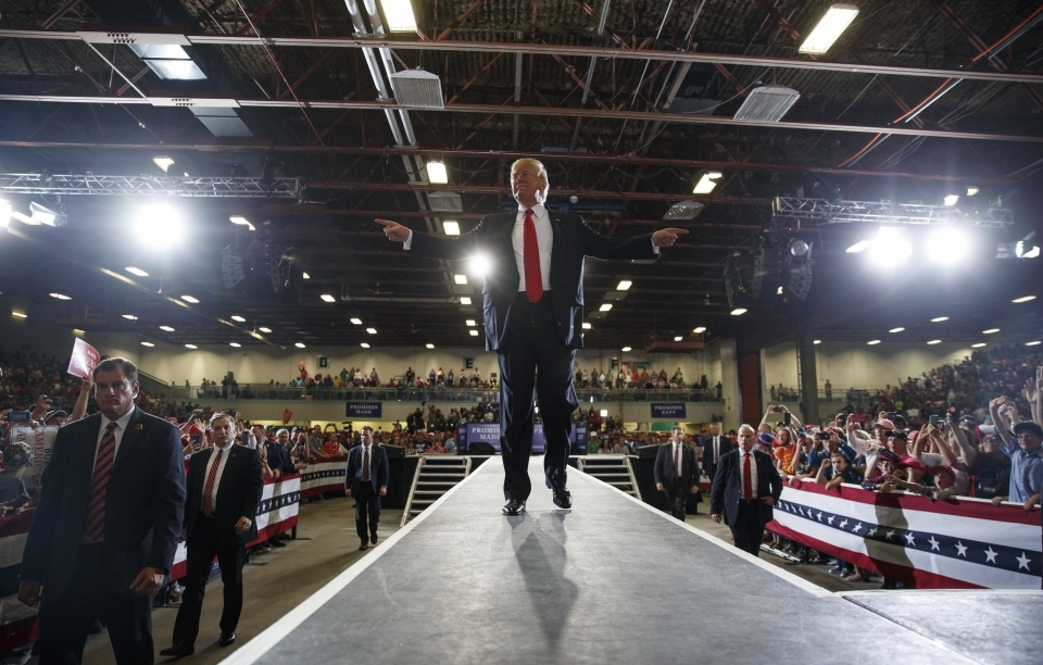 President Donald Trump reacts to the cheering crowd as he leaves a rally at on Thursday, July 5, 2018. (AP Photo/Carolyn Kaster)