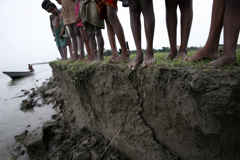 In this 2008 photo, a group of Bangladeshi children stand on the eroding banks of the river Jamuna, in Manikgonj, 40 kilometres, north of Bangladesh capital Dhaka. (AP Photo/Pavel Rahman)