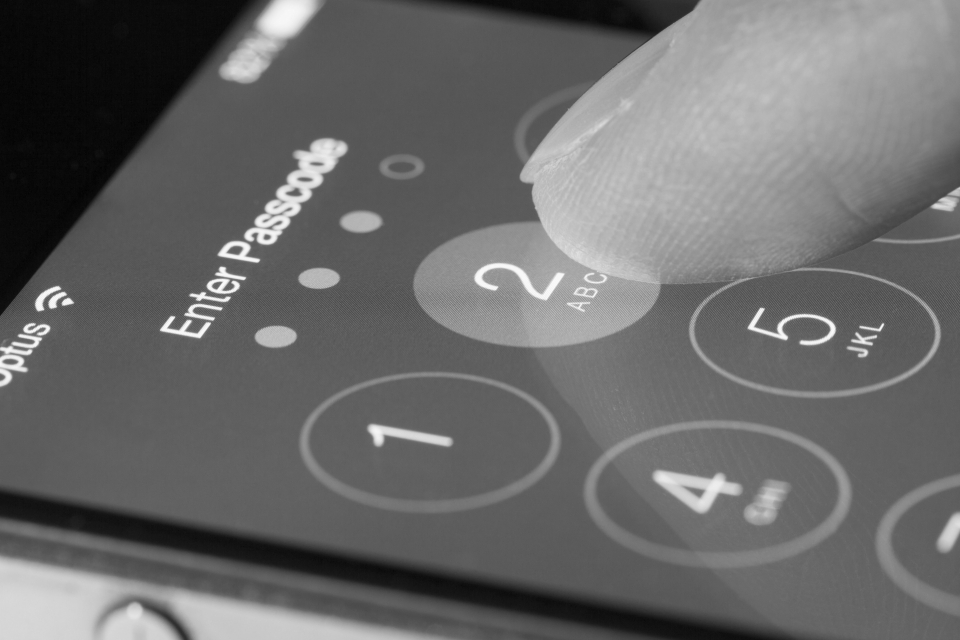 Recent advancements in device security by all major smartphone manufacturers have had significant implications for law enforcement investigations. Encryption security is now included on smartphones as a default setting and is linked to a passcode or other form of unlocking, such as fingerprint or facial recognition software. (Photo: ymgerman / Shutterstock.com)