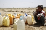 A boy waits for his turn to fill buckets with water from a public tap amid an acute shortage of water, on the outskirts of Sanaa, Yemen, Tuesday, Oct. 13, 2015. The war has taken a heavy toll on Yemen. More than 4,000 people have been killed, and the humanitarian crisis has left the impoverished country on the brink of famine.  (AP Photo/Hani Mohammed)