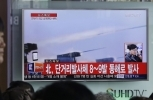 People watch a TV news program showing a file footage of the missile launch conducted by North Korea, at Seoul Railway Station in Seoul, South Korea, Thursday, March 3, 2016. (AP Photo / Ahn Young-joon)