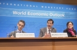 IMF Chief Economist Maurice Obstfeld and colleagues Gian Maria Milesi-Ferretti and Oya Celasun present the World Economic Outlook (IMF Staff Stephen Jaffe)