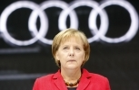 German Chancellor Angela Merkel stands in front of the Audi booth at the Frankfurt Auto Fair. (AP Photo/Frank Augstein)