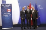 European Commission President Jean-Claude Juncker, right, European Council President Donald Tusk, left, and Canadian Prime Minister Justin Trudeau (AP Photo/Olivier Matthys)