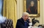 A portrait of Andrew Jackson, former US president, hangs on the wall behind Donald Trump (AP Photo/Alex Brandon)